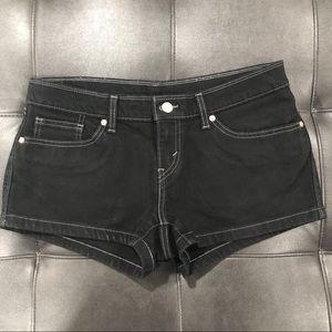 Levi's black denim shorts with white stitching